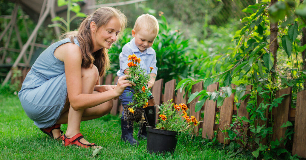 A mother and young child gardening